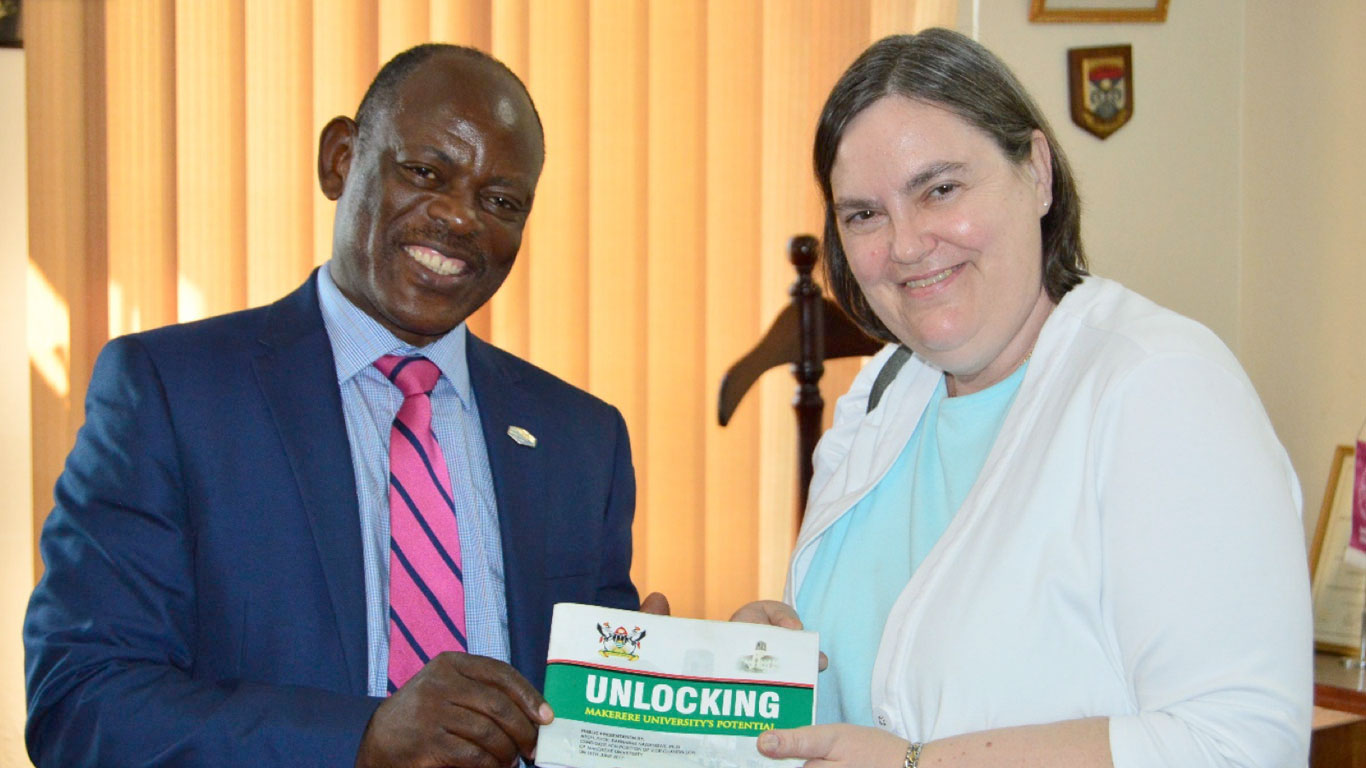 Prof. Barnabas Nawangwe presenting a copy of his Manifesto to Ms. Andrea Johnson